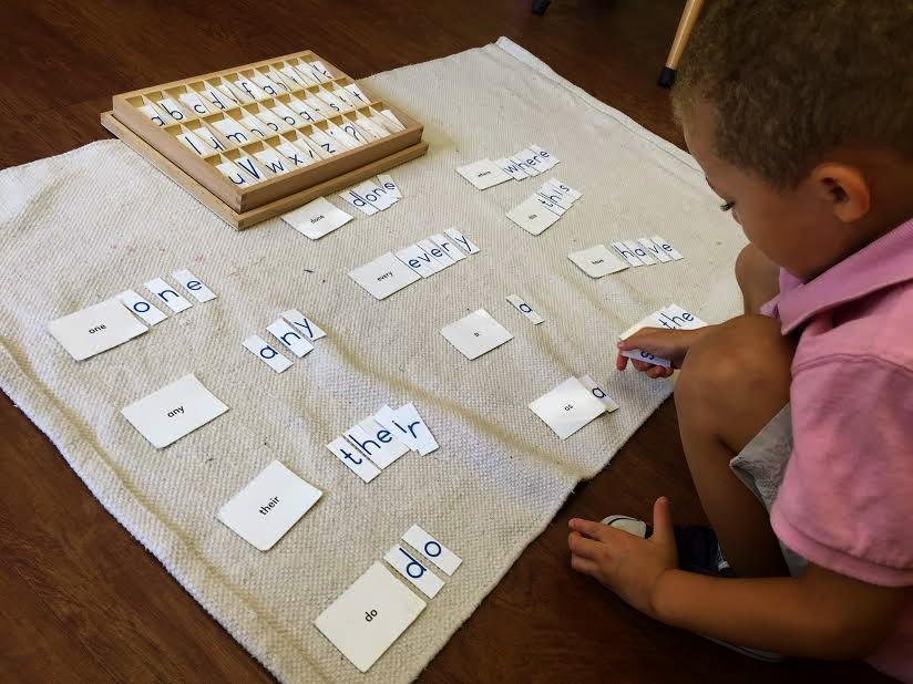 Checking his spelling and memorization of the first set of puzzle words.