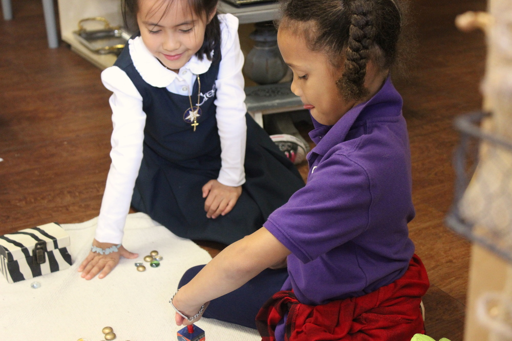 Two friends playing the dreidel game