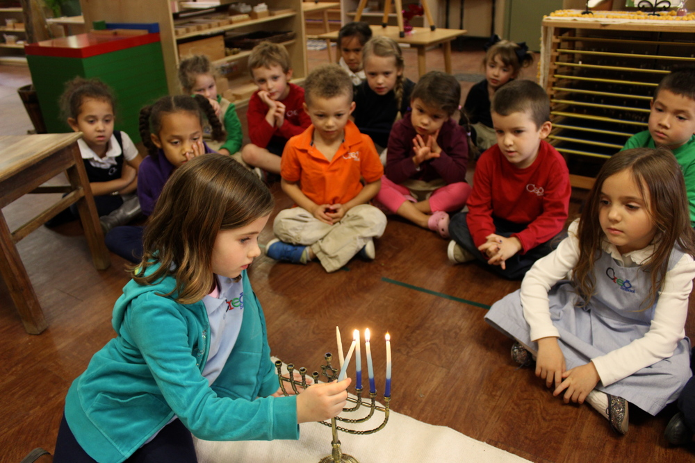 Lighting the menorah after discussing Hannukah