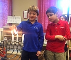 These two friends lighting up the Menorah after telling us the story behind the celebration of Hanukkah.