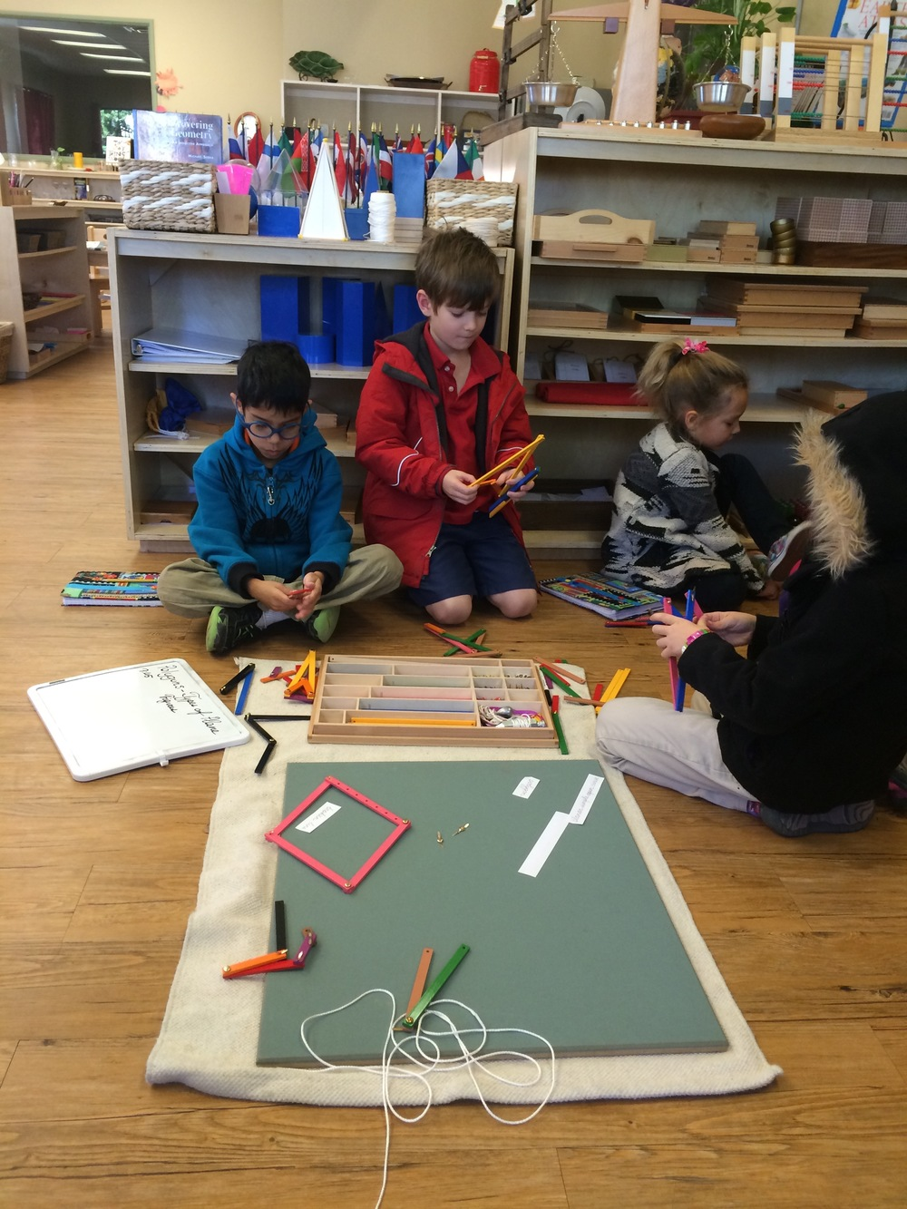 Using a plane and wooden sticks, this group is making polygons