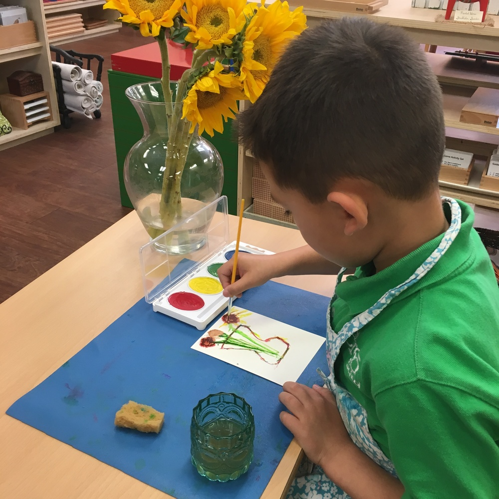 A child decided to paint the vase and sunflowers just like his favorite artist, Vincent Van Gogh!