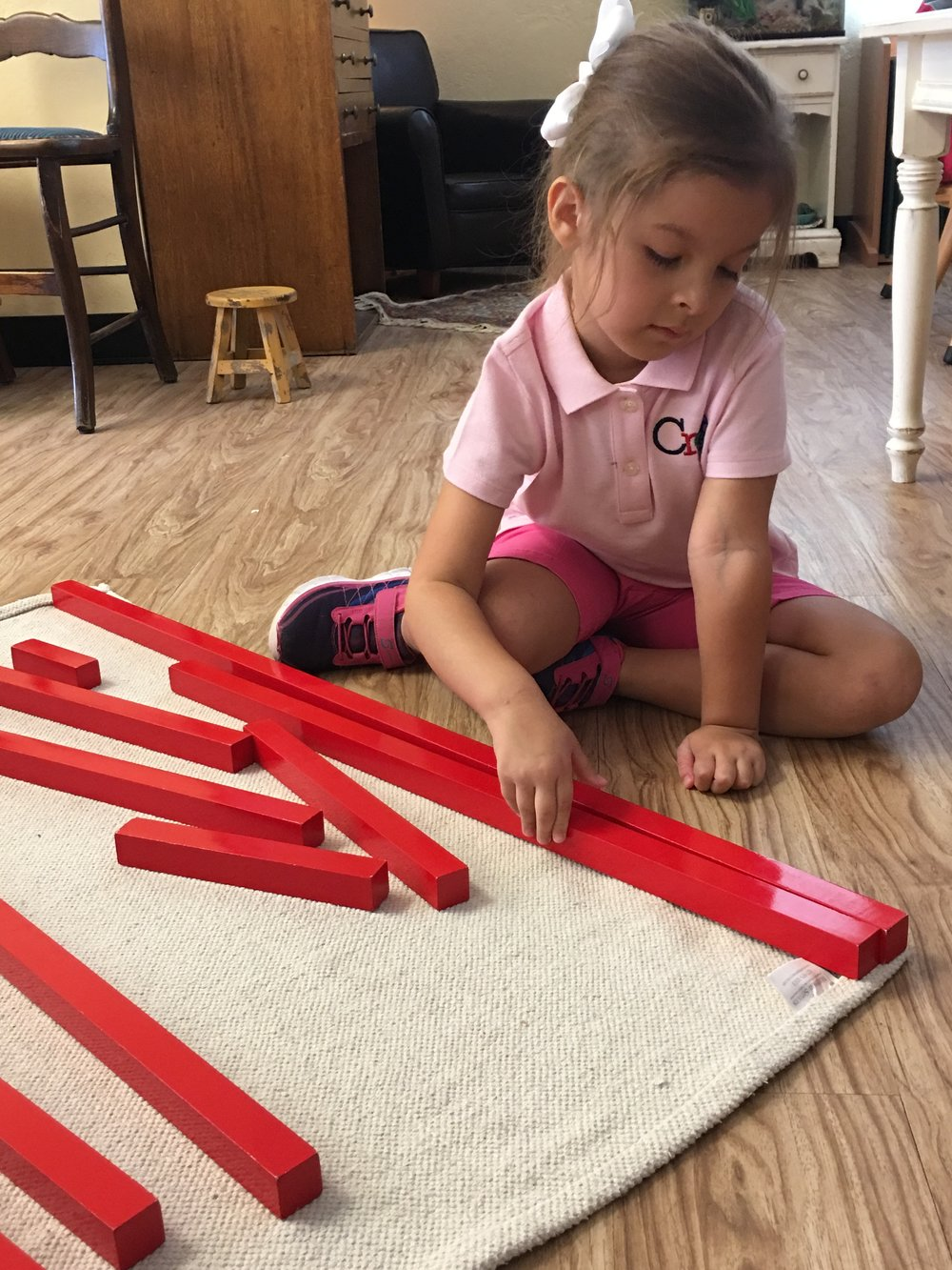 A child working on the red rods