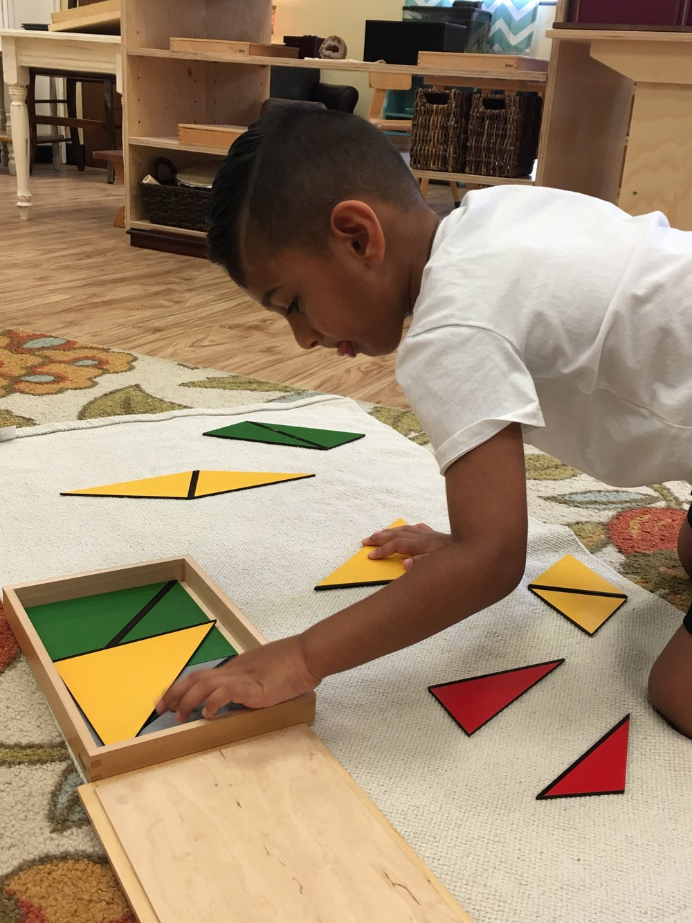 A child working with the rectangular box
