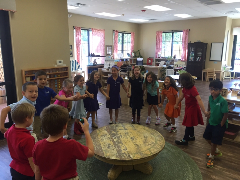 Children sining and dancing to one of they're favorite songs.