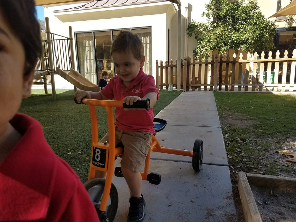 Playground: Scooting on the tricycle