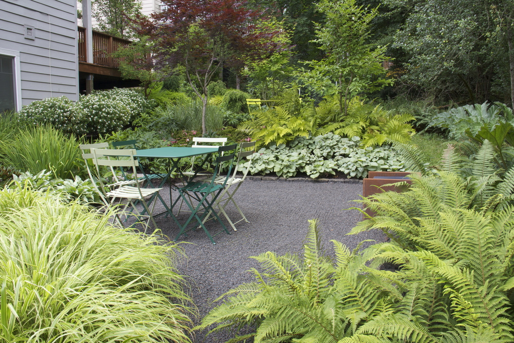After: subtle terracing made room for two outdoor living spaces, while textural plantings give the garden depth and focus.