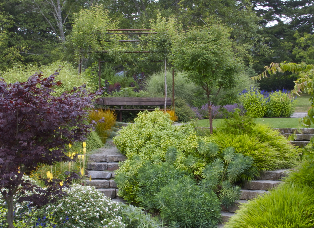 A Seating Area Doubles As A Focal Point In This Garden On The Oregon Coast.