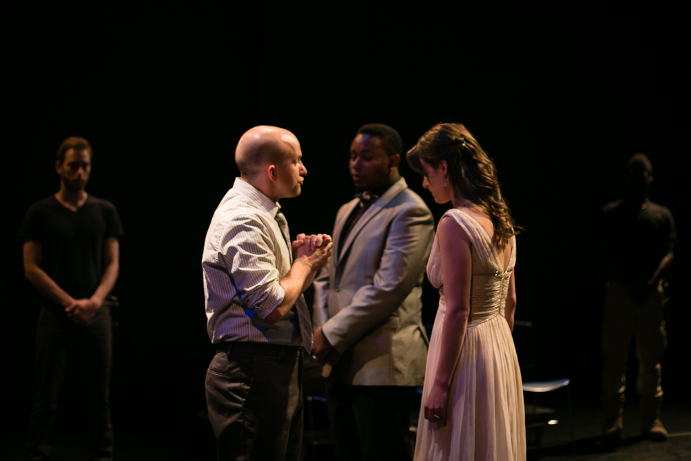 """...but here's my husband."" (L-R: Matthew Whitfield, Kevin Sims, Marcel Spears, Alice Renier, Jak Watson.)  The Tragedy of Othello, the Moor of Venice , Schapiro Theater, 2014. Photo by  Amy Sims ."