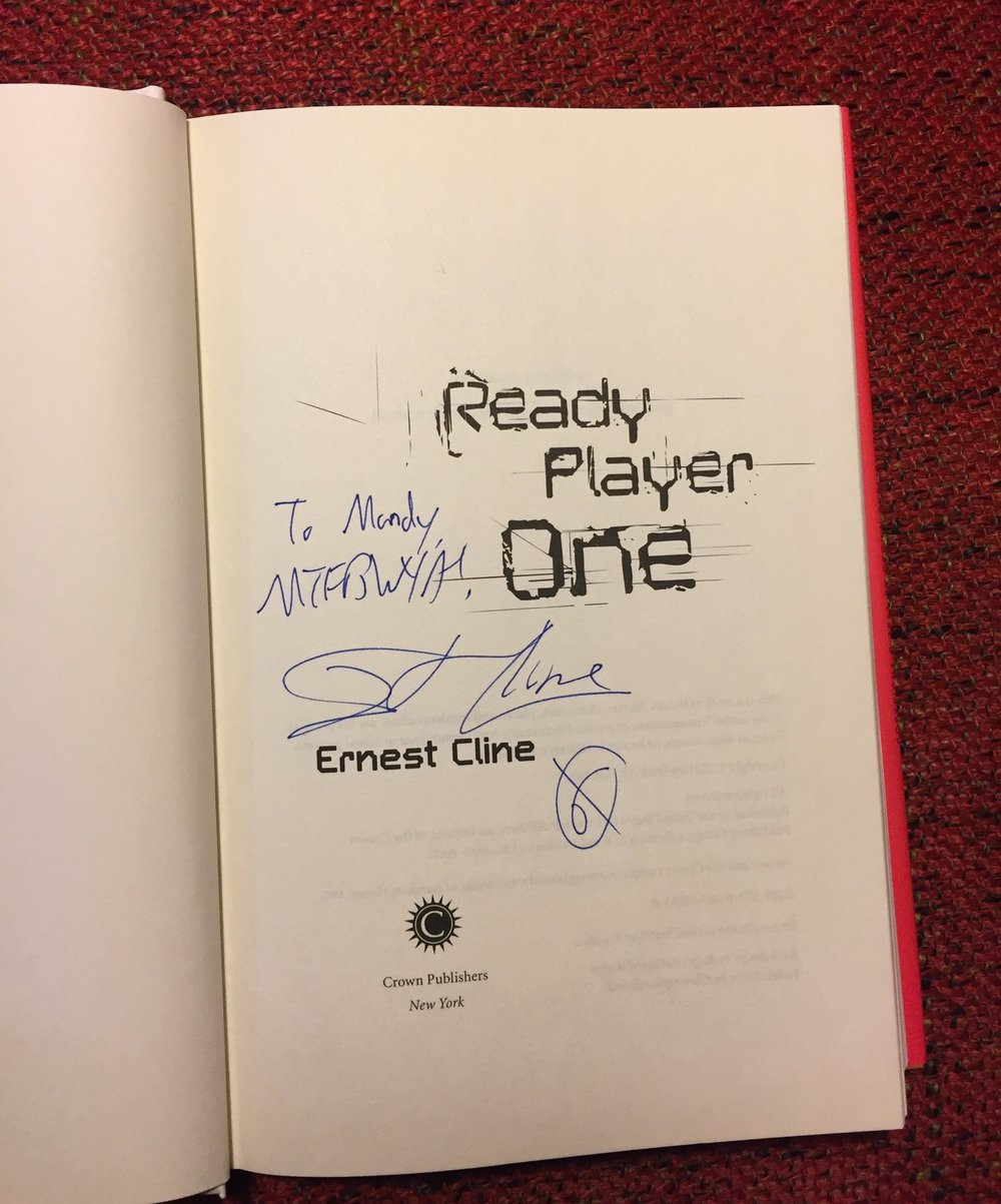 "[image description: the page in my copy of Ready Player One where the author signed the book. It says, ""To Mandy, MTFBWYA! - Ernest Cline."" The MTFBWYA acronym stands for May the Force Be With You Always."