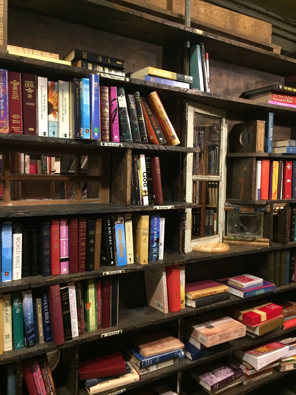 '[image description: A bookshelf with a window built into it. Just one of the many artistic touches in The Last Bookstore.]