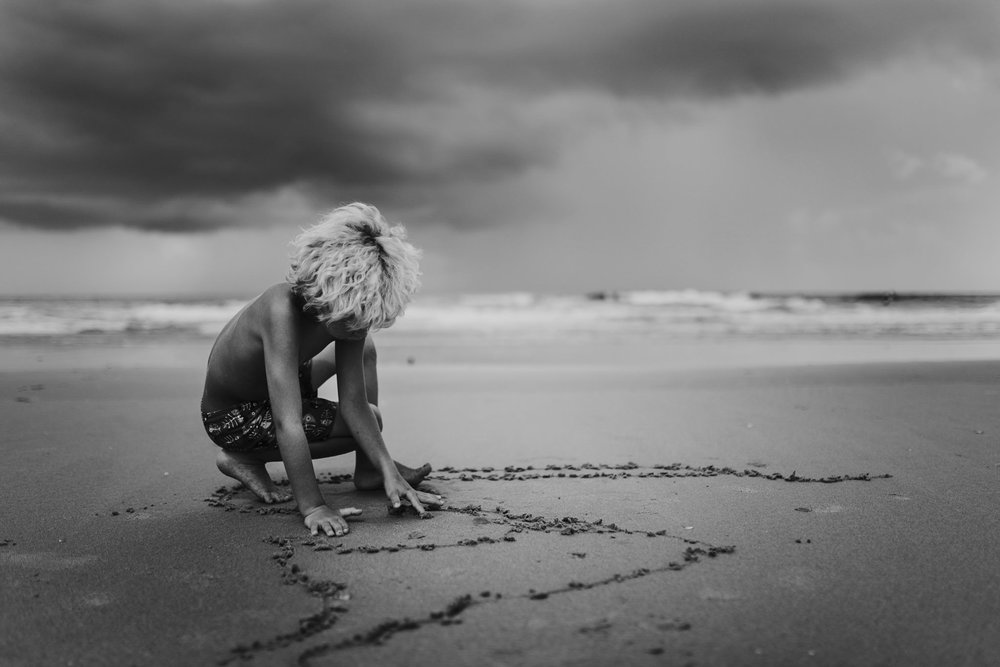 twyla jones photography - treasure coast florida - stormy beach boy playing in sand--24.jpg