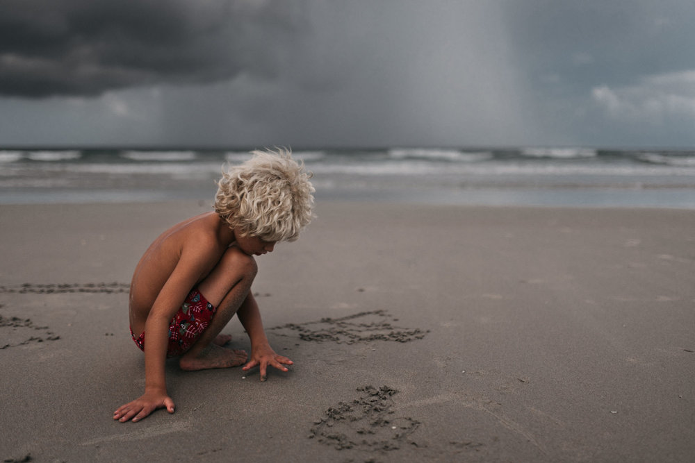 twyla jones photography - treasure coast florida - stormy beach boy playing in sand--29.jpg
