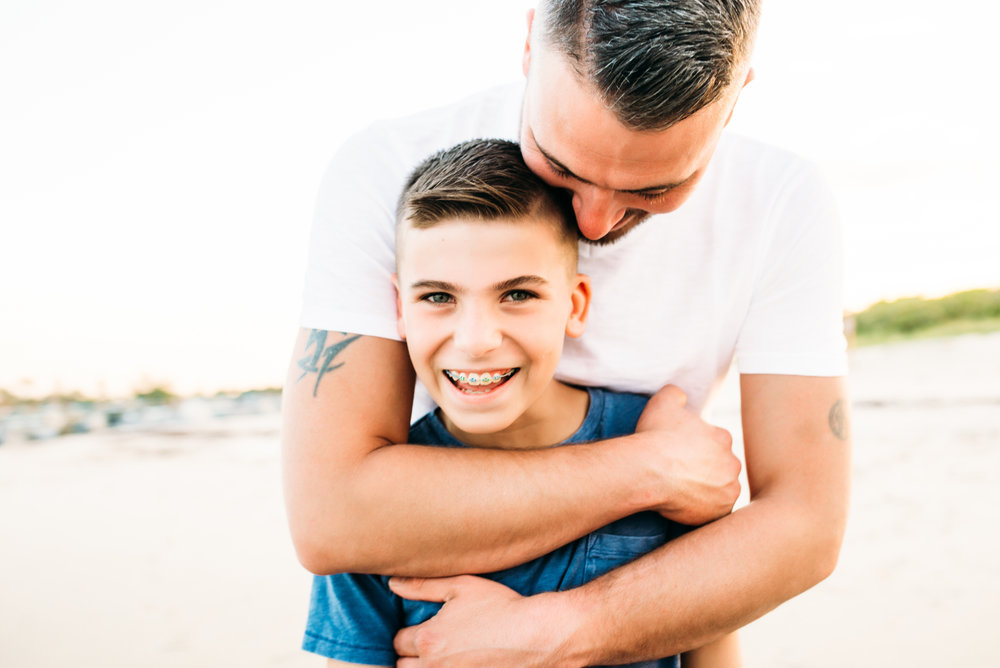 father son beach emotive family posing