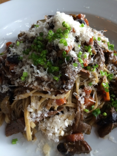 Slow cooked porcini ragu with fresh linguini and shaved parmesan.