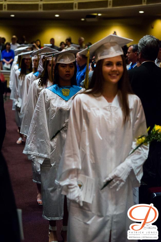 Girls holding roses | Catherine McAuley High School