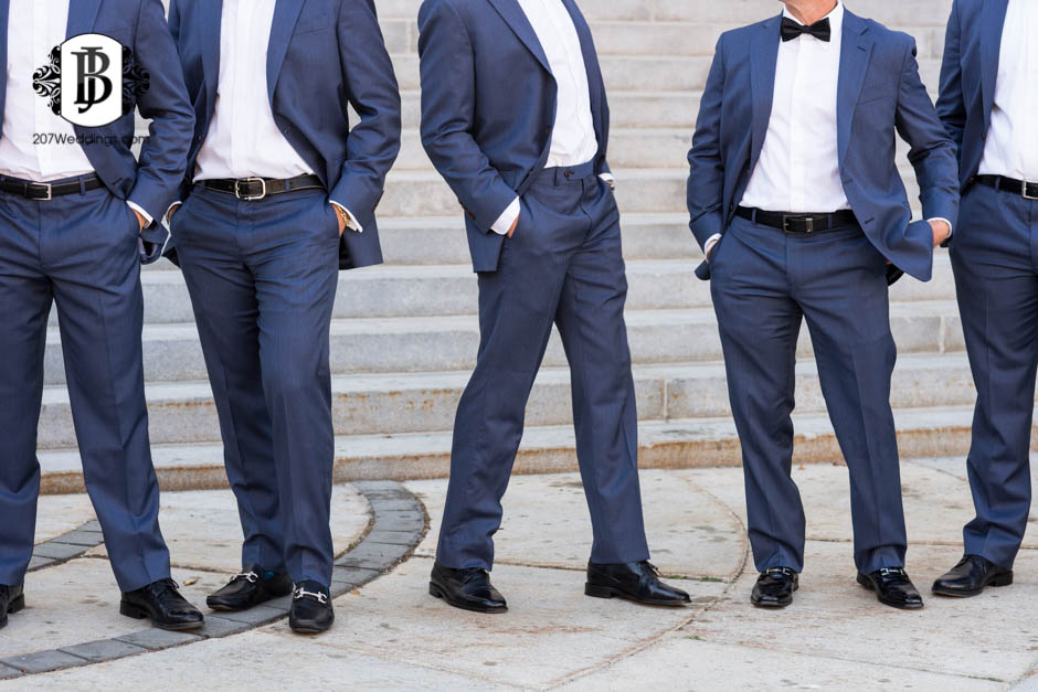 A Maine wedding photographer's close up portrait of a group of groomsmen's outfits as they are standing in line together
