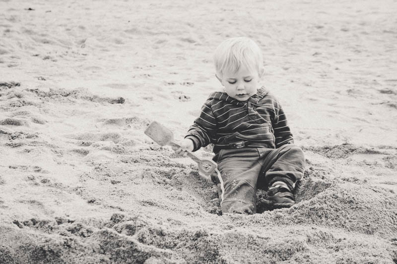 Tommy loving the sand at Fistral Beach