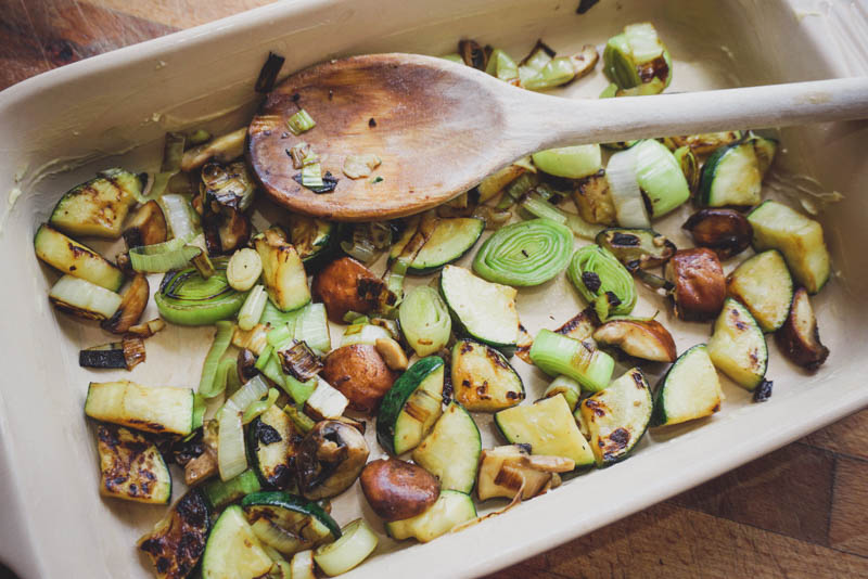 Add the fried veg to a greased baking dish