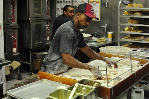 "Local bojangles' serves gameday fans  ""I'll tell you what,"" Frazier says, glancing over his shoulder, across the counter and into the kitchen. ""This is a great group of people that, when push comes to shove, they can really move food out of here."""