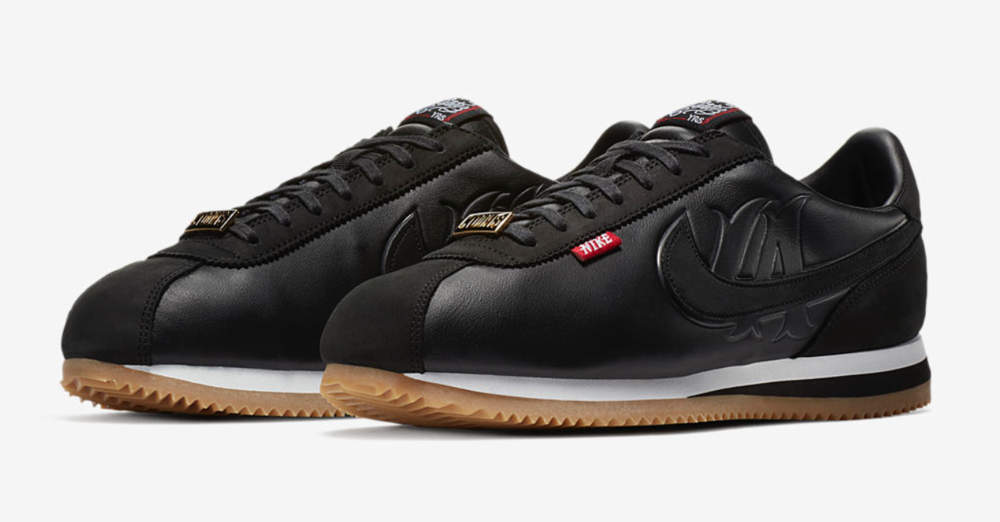 "This obsidian black colorway features custom-embroidered branding crafted by Mister Cartoon and a gum rubber sole for classic style that's true to California. The body is composed of premium leather & suede accents, this shoe features a custom ""LA"" symbol embodied within the traditional Nike Swoosh."