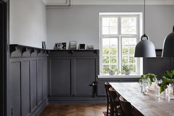 Dining room with herringbone parquet floor and painted wall panelling