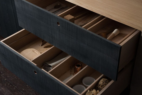 Interior of stained black kitchen drawer - Sebastian Cox for deVOL