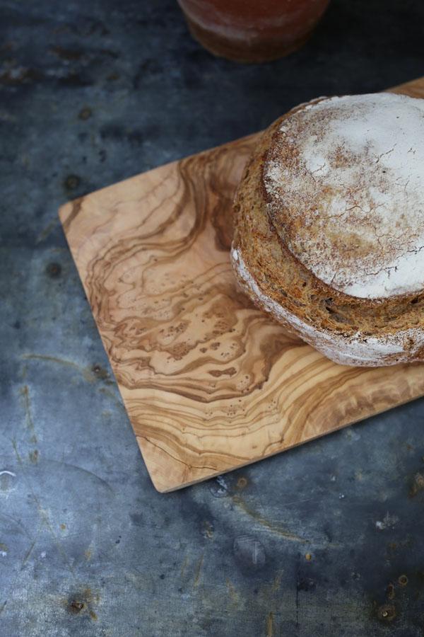 Wooden breadboard on zinc table