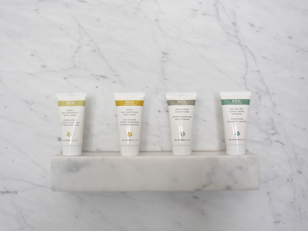 REN toiletries in marble bathroom At the Chapel | Design Hunter
