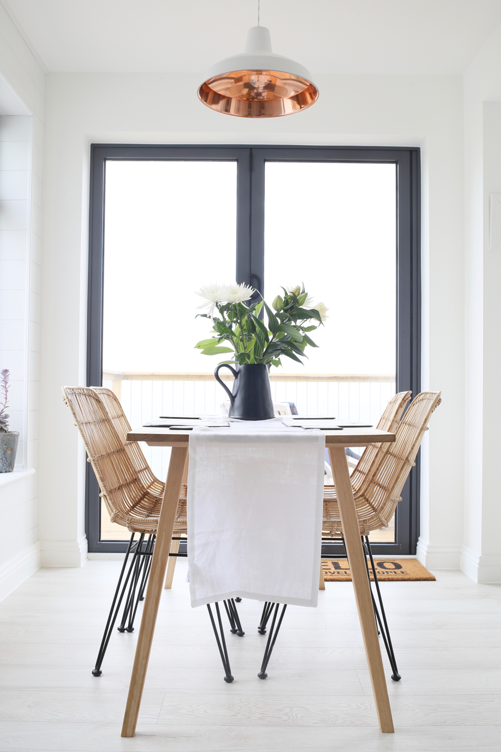 Dining table with rattan chairs | Design Hunter