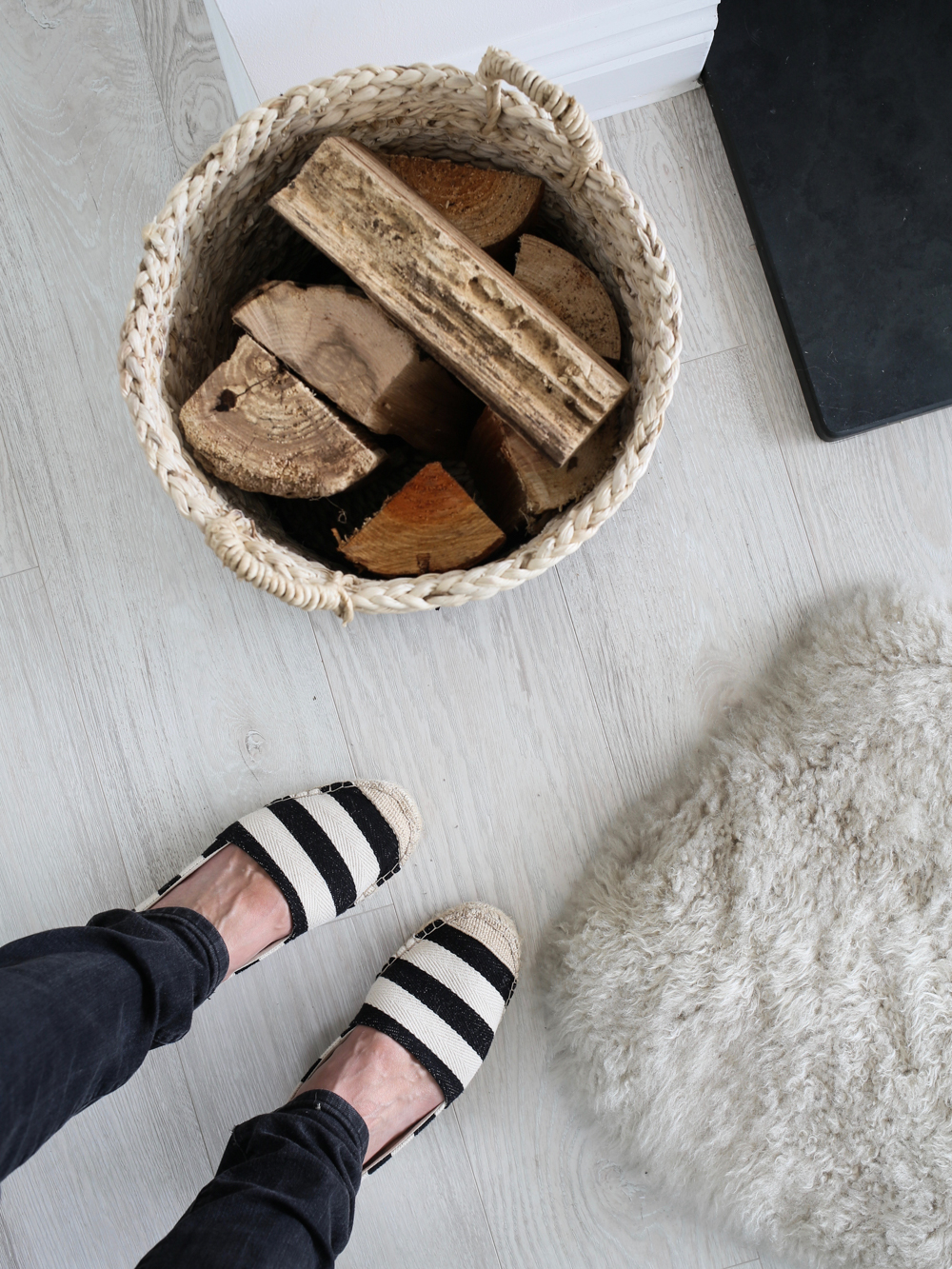 Fire logs and fur rug | Design Hunter
