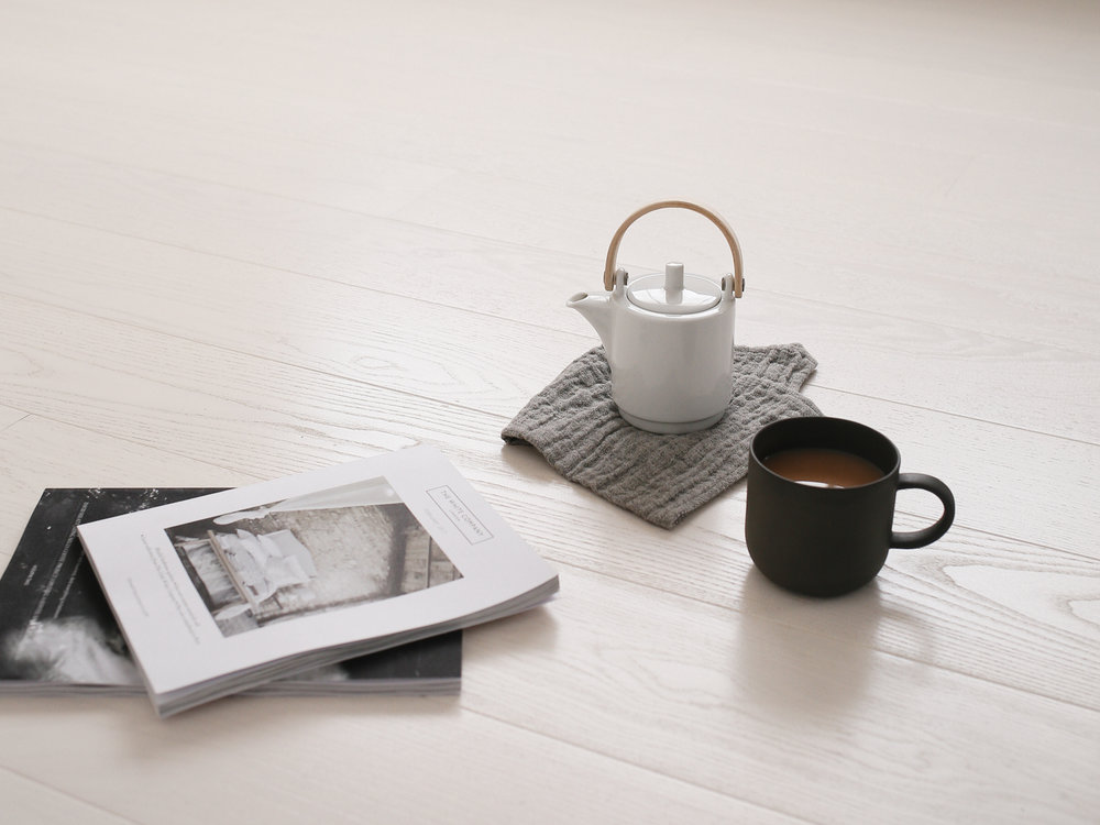 Tea on white ash studio floor | Design Hunter