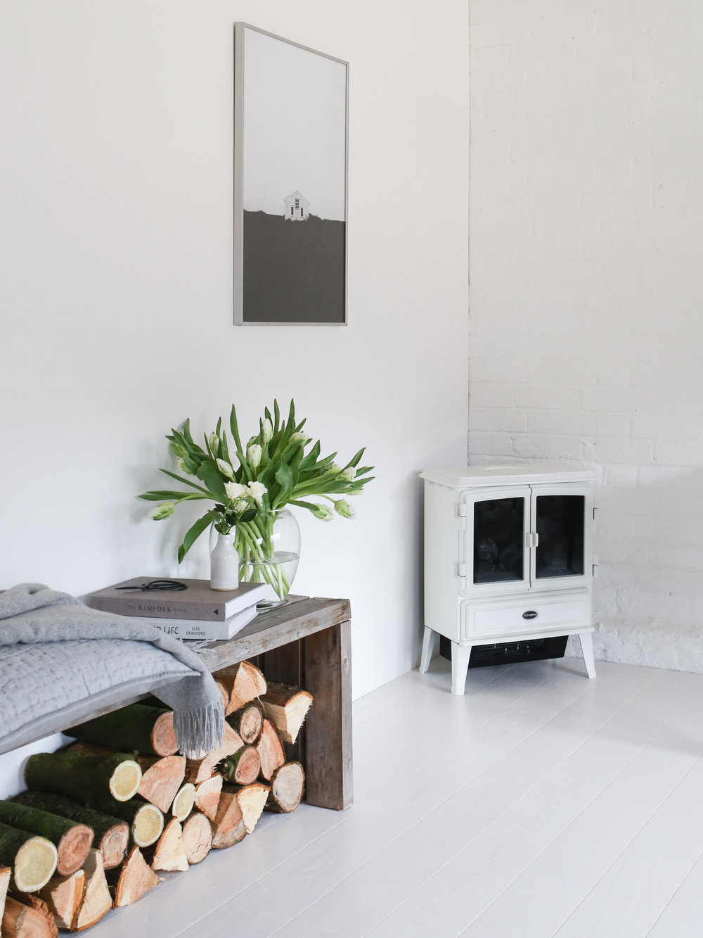 White Dimplex stove and wooden bench | Design Hunter