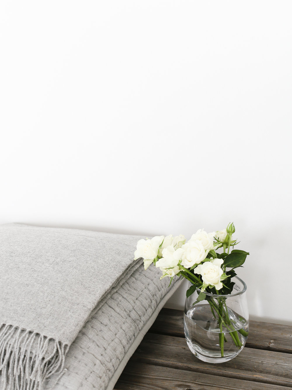 Spray roses with grey alpaca throw and cushion