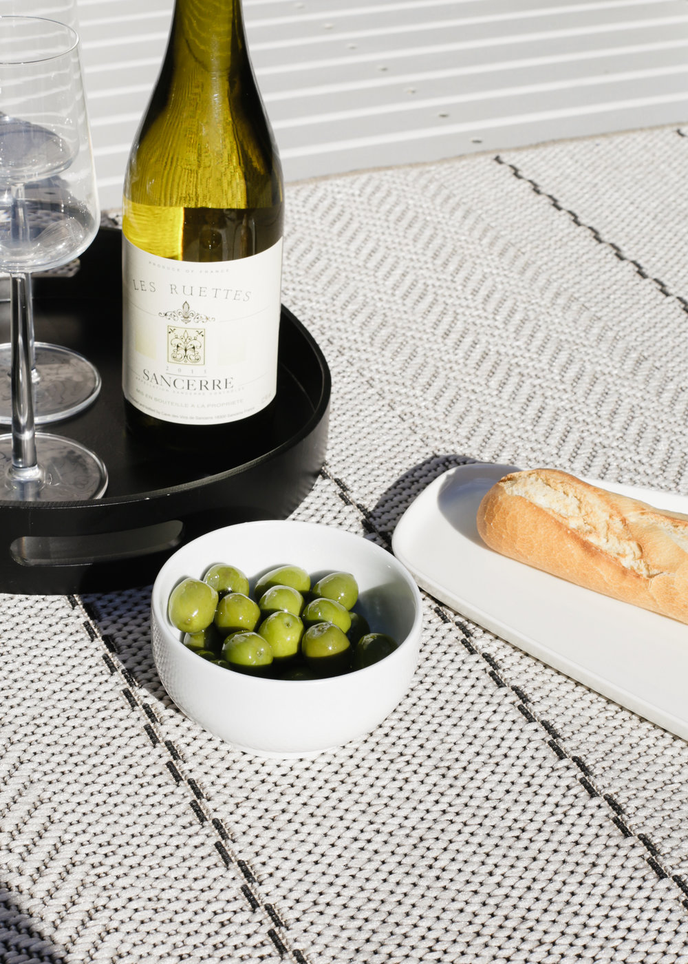 Dining al fresco Sancerre olives and baguette | Design Hunter
