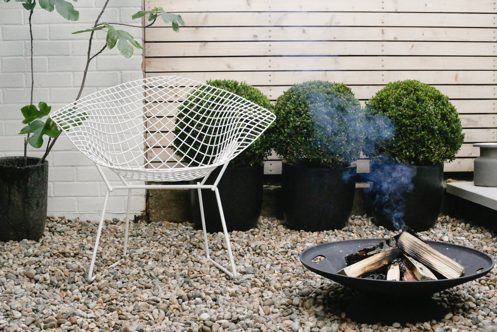 Skagerak firebowl and Bertoia chair | Design Hunter