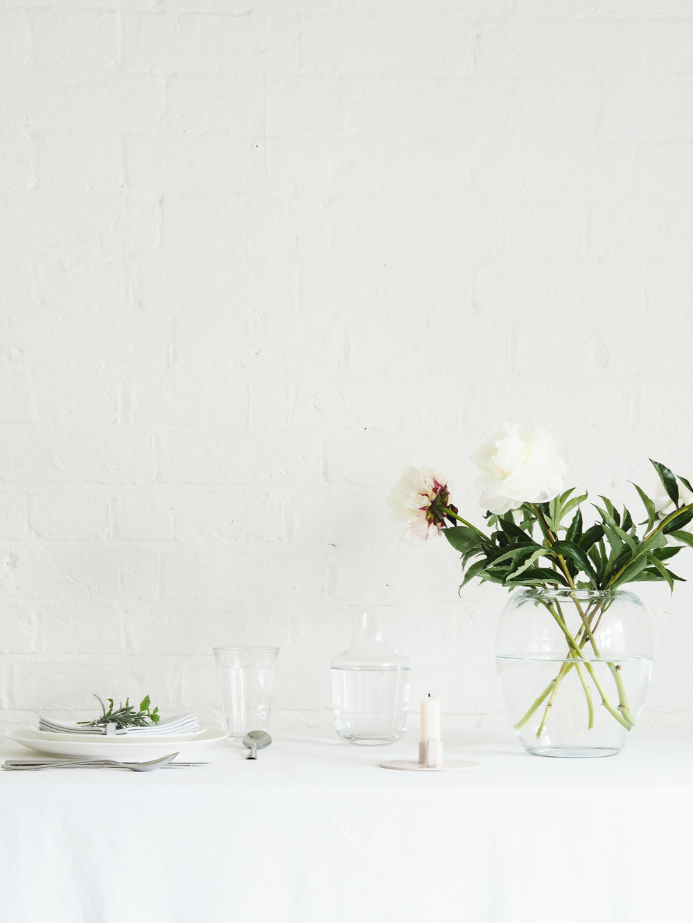 Vase of peonies on dining table | Design Hunter