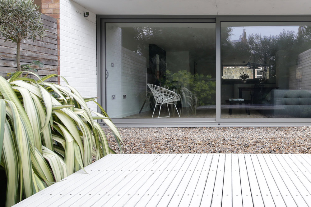 The full width patio doors in our old 1960s style house