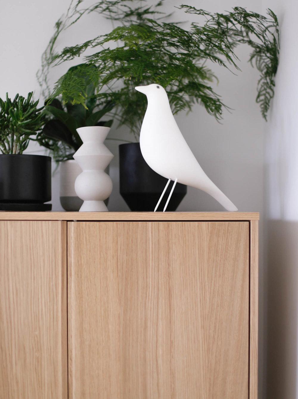 Plants and white Vitra house bird