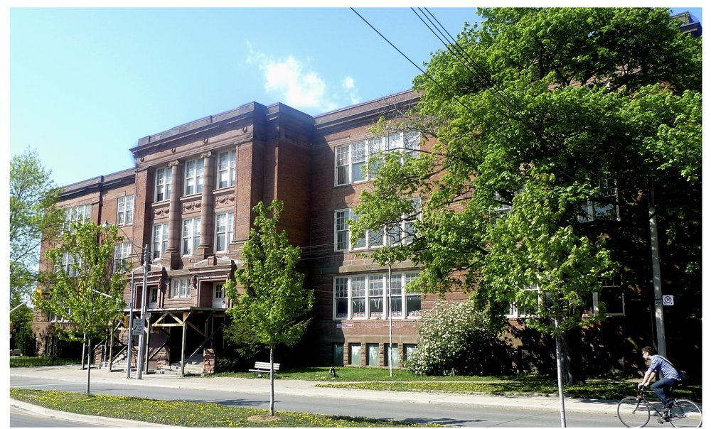 Shaw Street School, originally redirected to the war effort, used as a barrack 1914 - 1918. Toronto District School Board Public School, 1919 - 2000.  Sold to Artscape for transformations into a community arts hub. Opened as Artscape Youngplace in 2013.