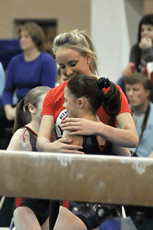 Nastia celebrates a great beam routine with Macy