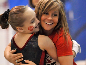 Shawn Johnson congratulates Reagan after bars