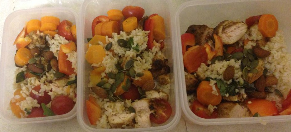 Dejan's pre-made lunch meals for the office: Brown rice, chicken, carrots, cherry tomatoes, mushrooms, sesame seeds
