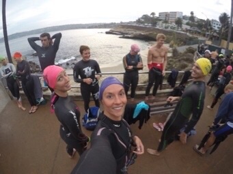 HAPPY SWIMMERS GETTING INTO THEIR WETSUITS AT THE COVE