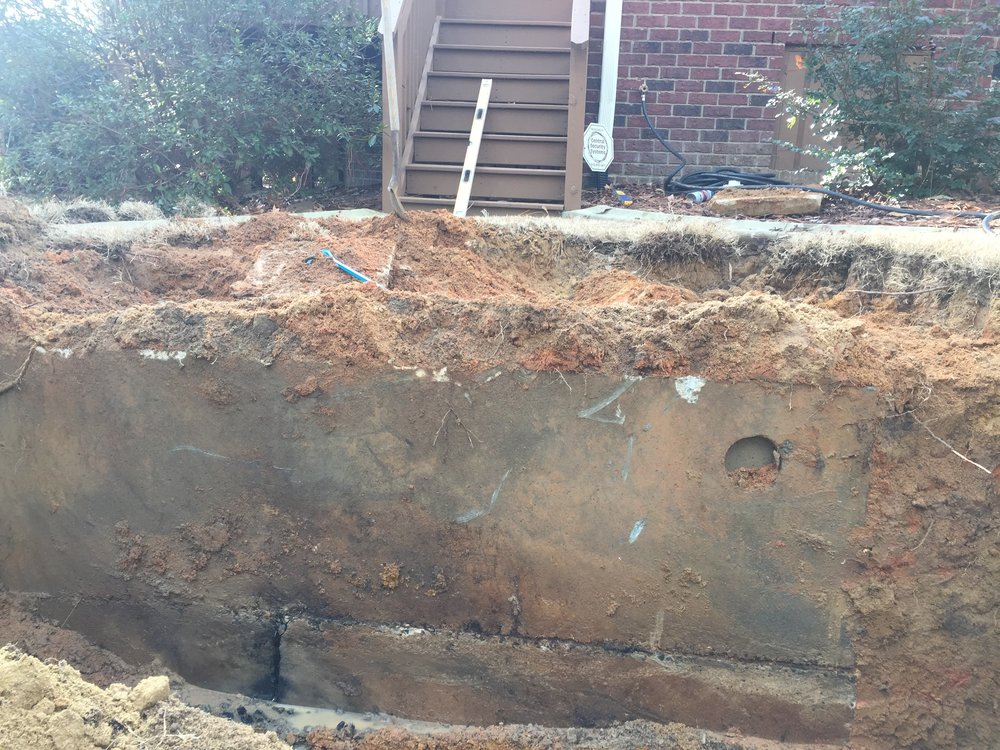 Side of Leaking Septic Tank