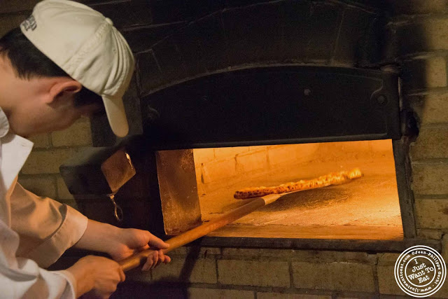 image of oven and pizza making at Luzzo's with Scott's pizza tours in NYC, New York