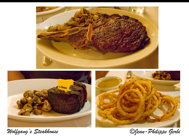 Image of steaks and onion rings at Wolfgang's steakhouse in NYC, New York