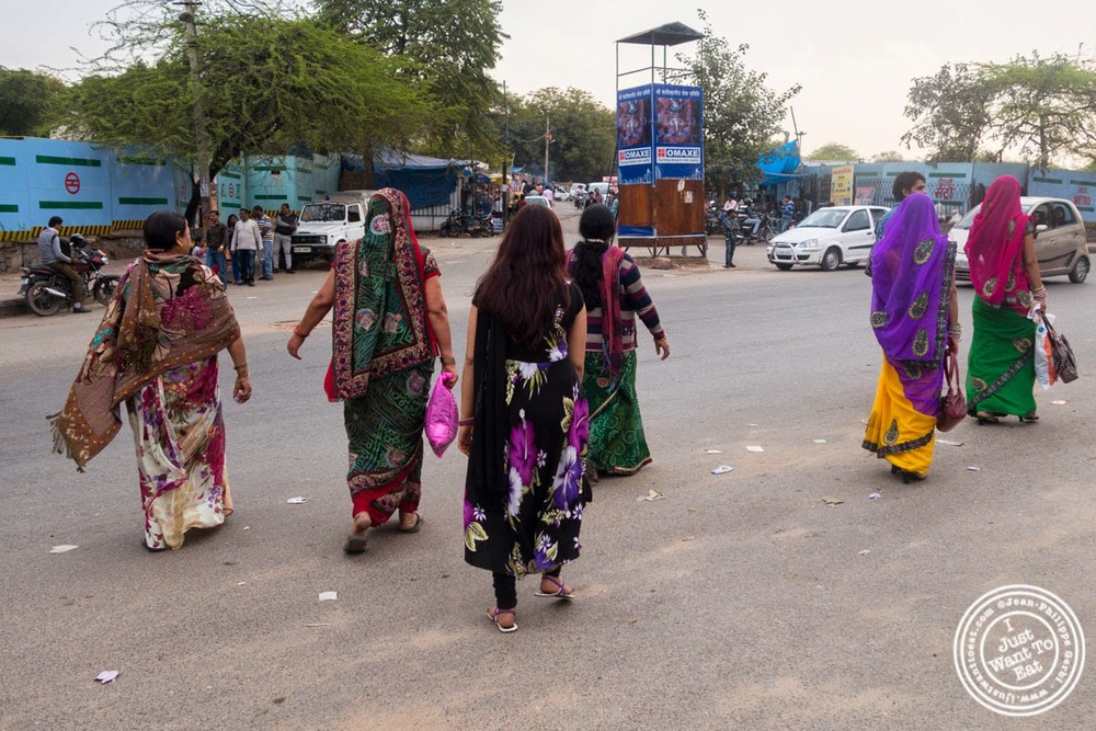 Women crossing the street in Delhi, India