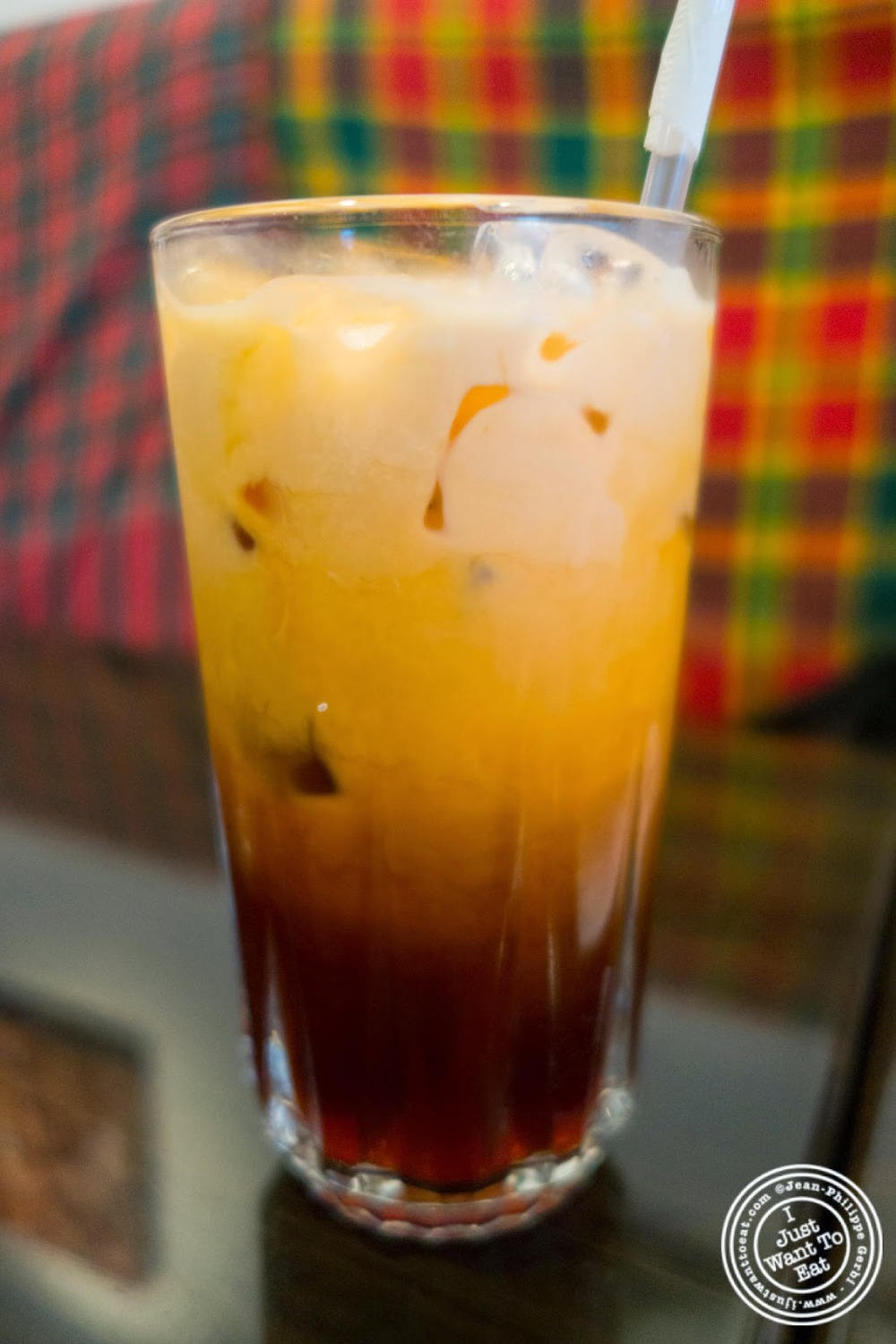 Thai iced tea at Larb Ubol, Thai restaurant in Hell's Kitchen, NYC, New York