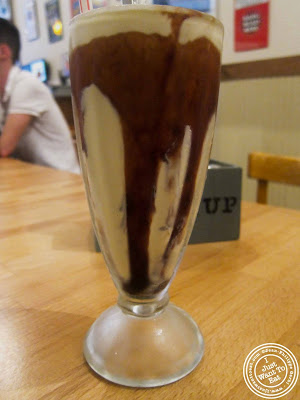Image of black and white milkshake at Island Burgers and Shakes in Hell's Kitchen, NYC, New York